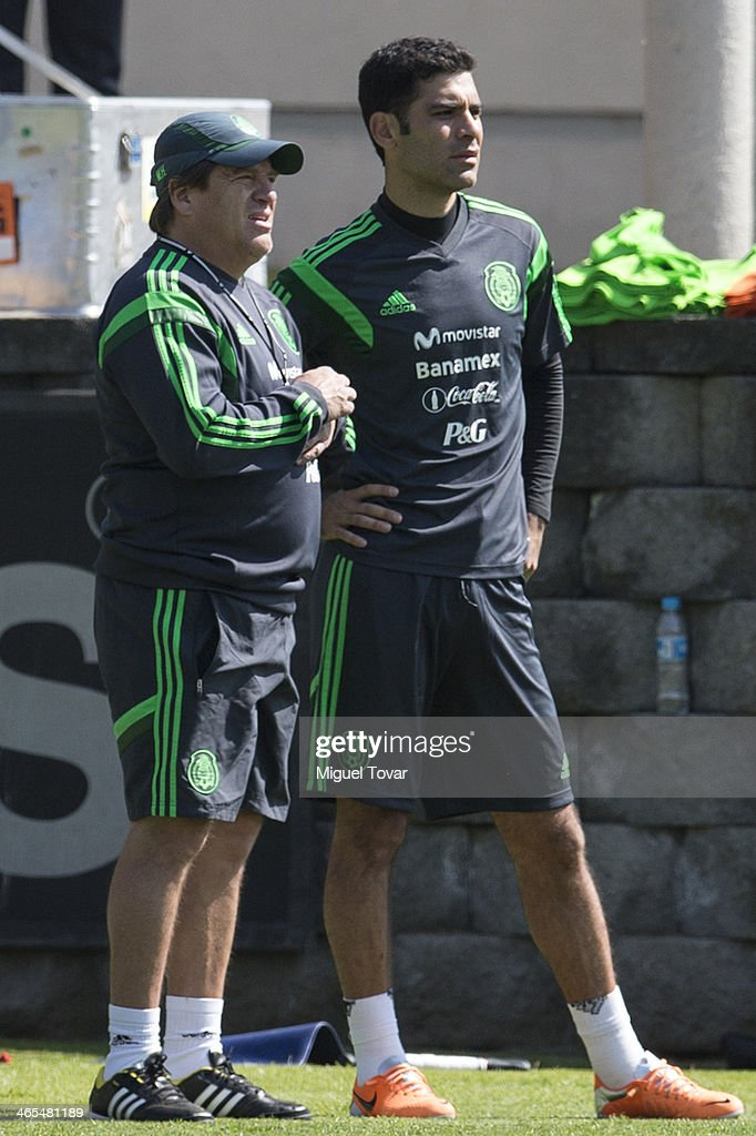 Coach Miguel Herrera and Rafael Marquez of Mexican National soccer team talk during a training session at CAR on January 27, 2014 in Mexico City, Mexico. The team is preparing to face Korea in a friendly match before the FIFA World Cup in Brazil.