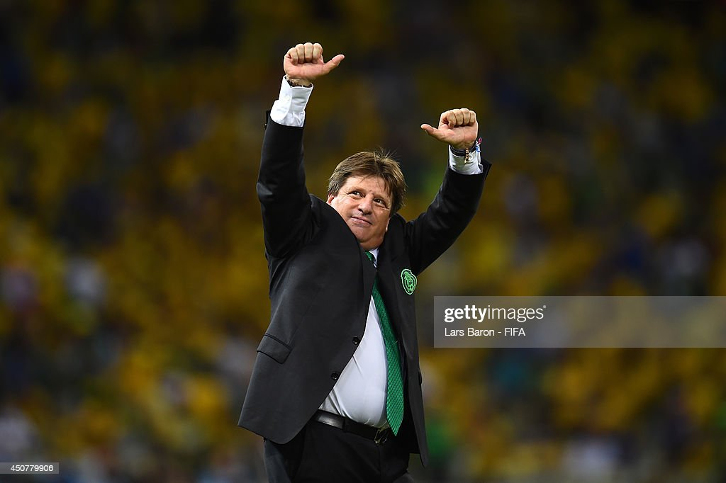 Coach <a gi-track='captionPersonalityLinkClicked' href=/galleries/search?phrase=Miguel+Herrera+-+Soccer+Coach&family=editorial&specificpeople=12319687 ng-click='$event.stopPropagation()'>Miguel Herrera</a> of Mexico applauds the fans after the 2014 FIFA World Cup Brazil Group A match between Brazil and Mexico at Estadio Castelao on June 17, 2014 in Fortaleza, Brazil.