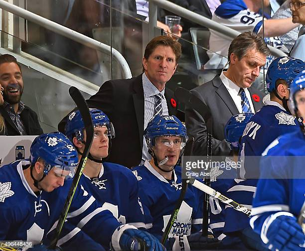 Coach Mike Babcock of the Toronto Maple Leafs watches the play develop against the Winnipeg Jets during game action on November 4 2015 at Air Canada...