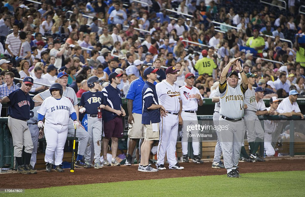 Coach Mike Doyle, D-Pa., calls for time out during the Congressional Baseball game where the Democrats beat the Republicans 22-0 at Nationals Park.