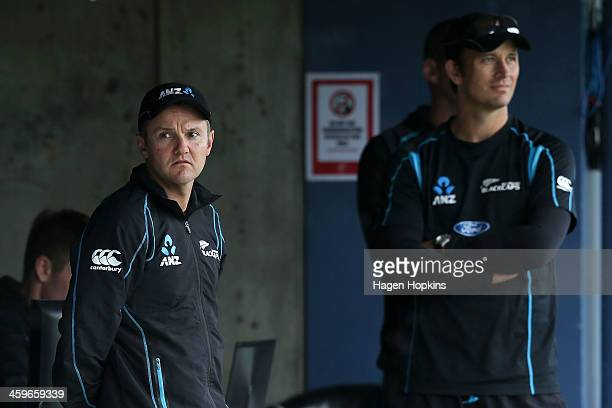 Coach Mike Hesson and bowling coach Shane Bond look on during a rain delay before the eventual abandonment of game two of the One Day International...