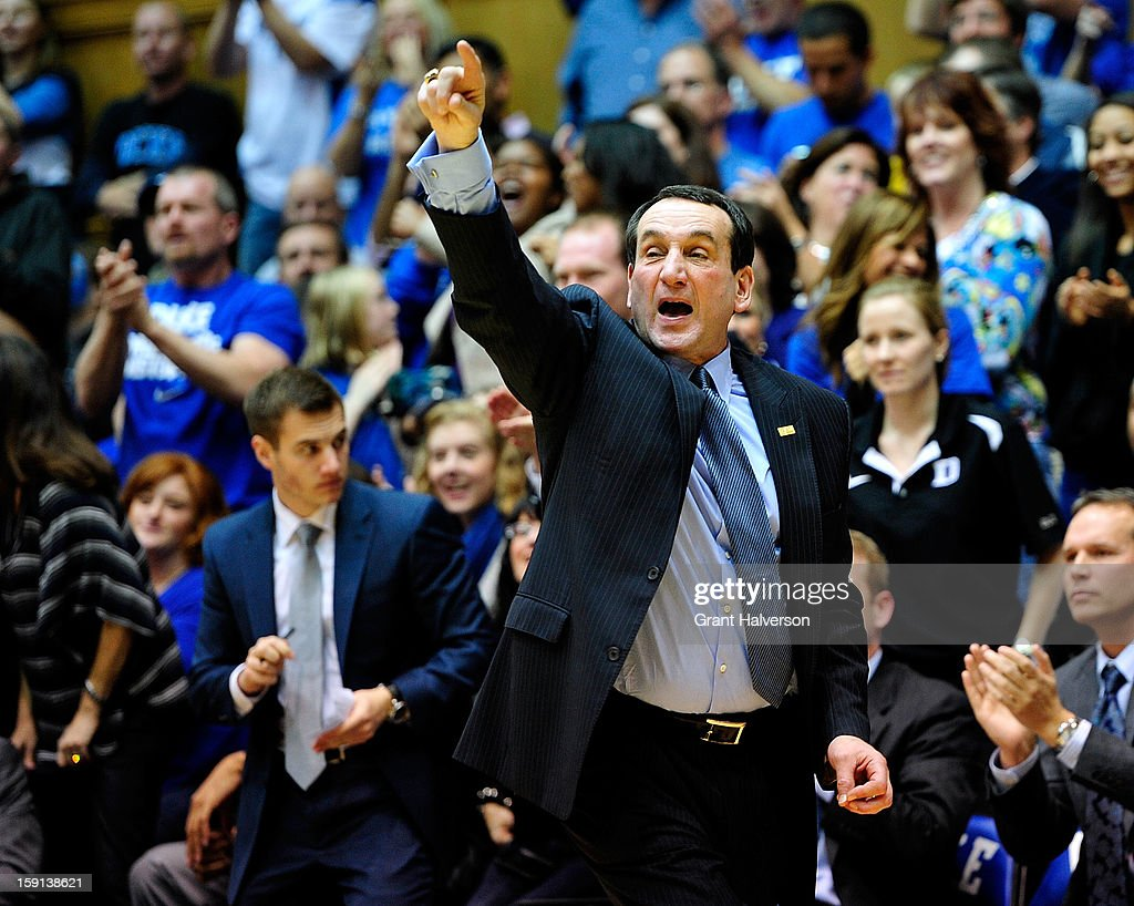 Coach <a gi-track='captionPersonalityLinkClicked' href=/galleries/search?phrase=Mike+Krzyzewski&family=editorial&specificpeople=213322 ng-click='$event.stopPropagation()'>Mike Krzyzewski</a> of the Duke Blue Devils directs his team against the Clemson Tigers at Cameron Indoor Stadium on January 8, 2013 in Durham, North Carolina. Duke won 68-40.