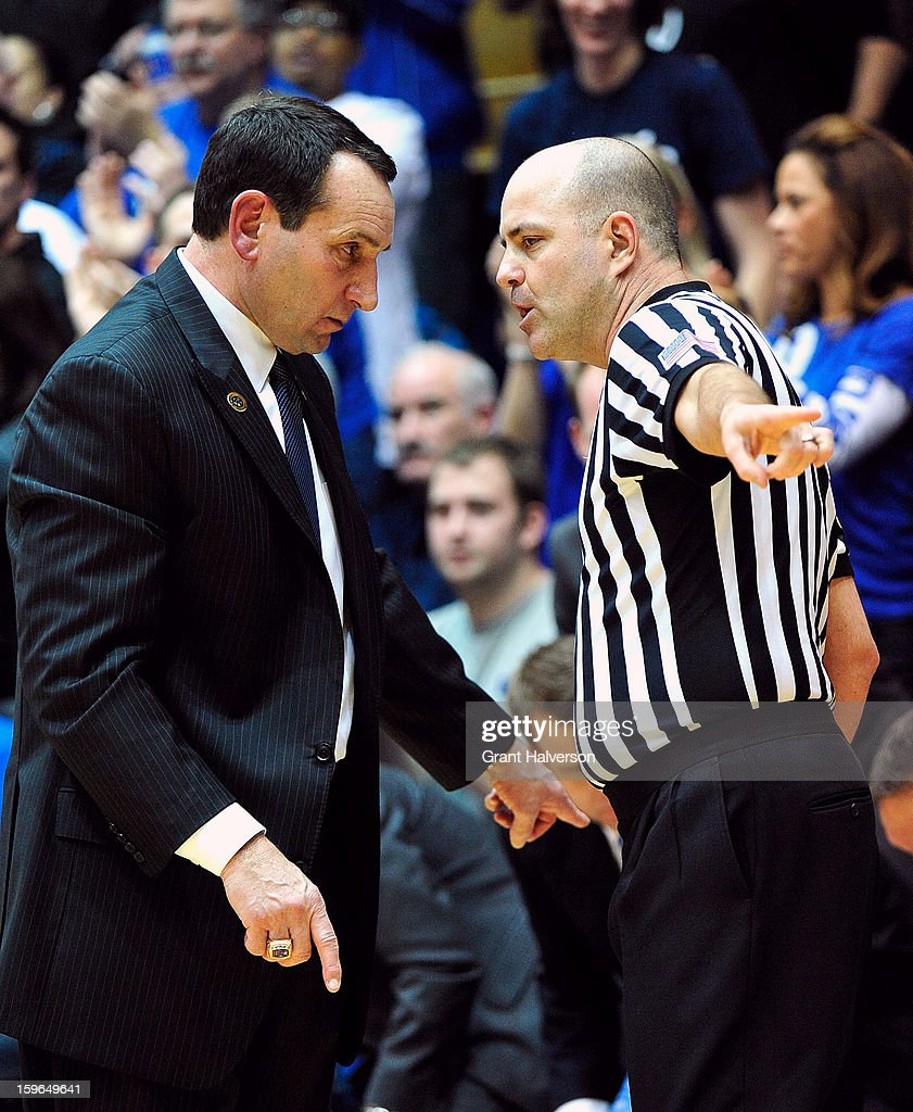 Coach Mike Krzyzewski of the Duke Blue Devils talks with an official during a game against the Georgia Tech Yellow Jackets at Cameron Indoor Stadium on January 17, 2013 in Durham, North Carolina. Duke won 73-57.