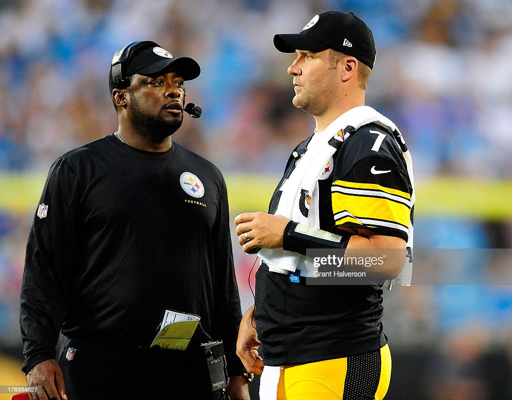 Coach Mike Tomlin and quarterback Ben Roethlisberger #7 of the Pittsburgh Steelers watch during a preseason NFL game against the Carolina Panthers at Bank of America Stadium on August 29, 2013 in Charlotte, North Carolina.