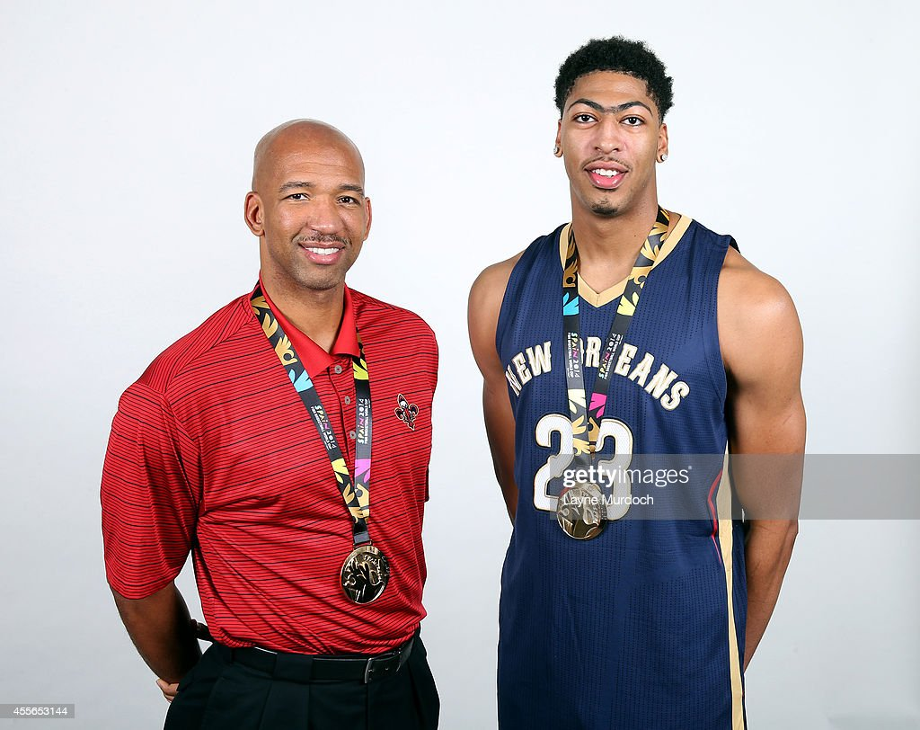 Coach Monty Williams and Anthony Davis of the New Orleans Pelicans show off their gold medals after helping USA Basketball win the 2014 FIBA World...