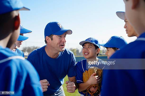 Coach Motivating Little League Team