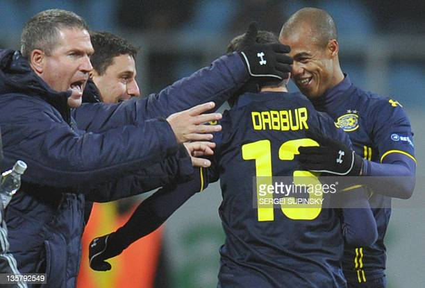Coach Motti Iwanir Munas Dabbur and Nivaldo of Maccabi TelAviv FC reacts as Munas Dabbur scored to FC Dynamo Kiev during UEFA Europa League Group E...
