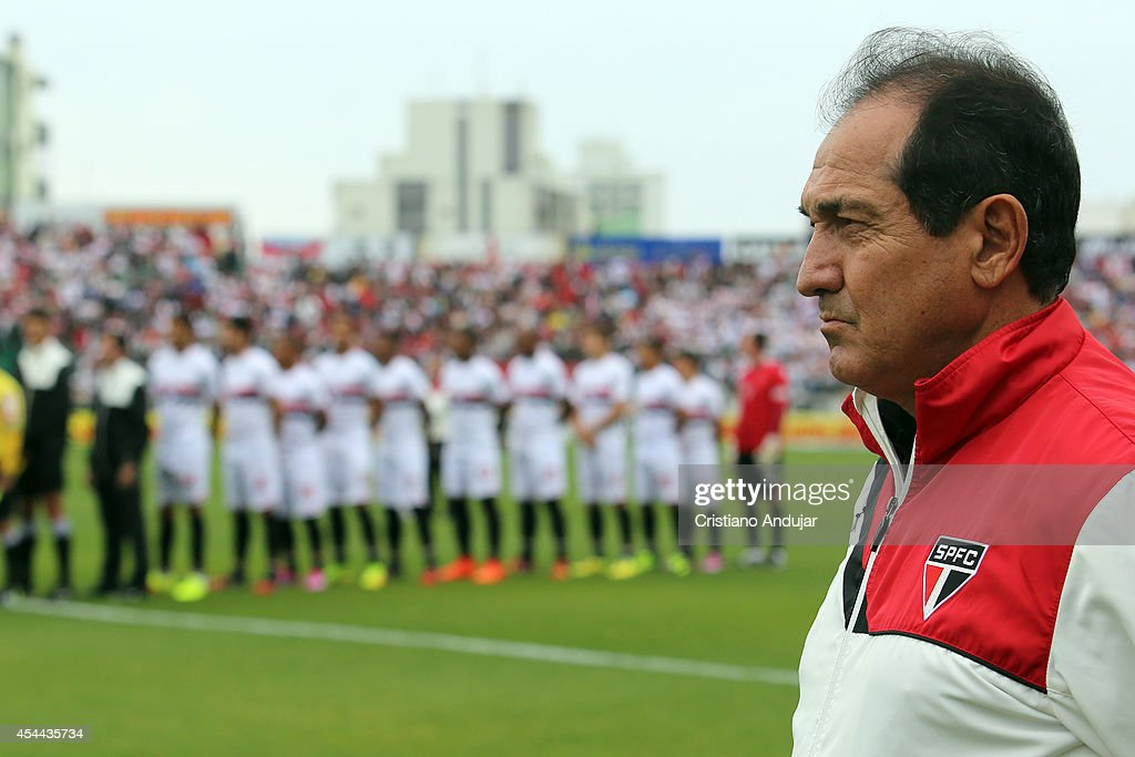 Coach Muricy Ramalho of Sao Paulo looks on during the national anthem prior during a match between Figueirense and Sao Paulo as part of Campeonato Brasileiro 2014 at Orlando Scarpelli Stadium on August 31, 2014 in Florianopolis, Brazil