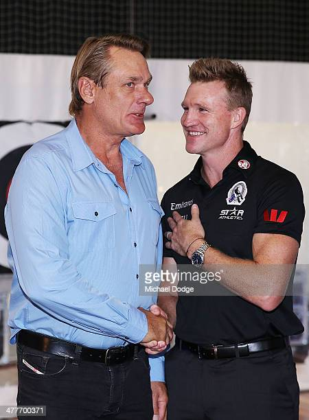 Coach Nathan Buckley and former captain Peter Moore shake hands during the Collingwood Magpies AFL season launch at the Westpac Centre on March 11...