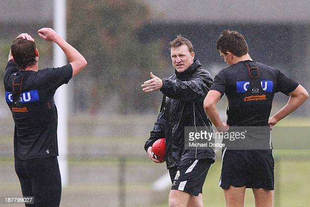 Coach Nathan Buckley gestures to a player during a Collingwood Magpies AFL media opportunity at the Westpac Centre on November 13 2013 in Melbourne...