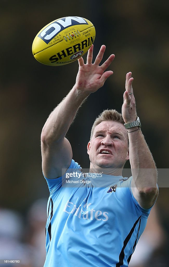 Coach <a gi-track='captionPersonalityLinkClicked' href=/galleries/search?phrase=Nathan+Buckley&family=editorial&specificpeople=176545 ng-click='$event.stopPropagation()'>Nathan Buckley</a> marks the ball during a Collingwood Magpies AFL session at Westpac Centre on February 12, 2013 in Melbourne, Australia.