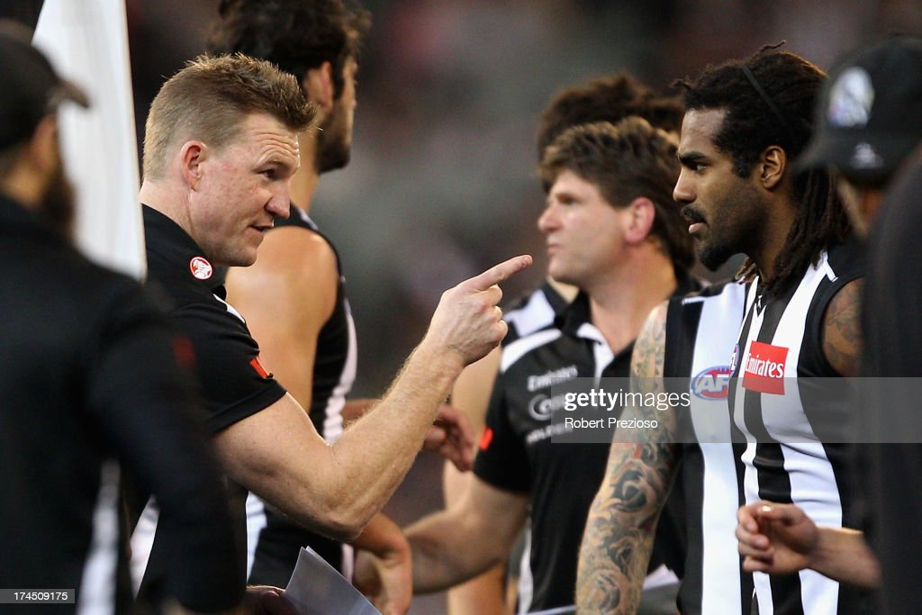 Coach Nathan Buckley of the Magpies speaks with Harry O'Brien of the Magpies during the round 18 AFL match between the Collingwood Magpies and the Greater Western Sydney Giants at Melbourne Cricket Ground on July 27, 2013 in Melbourne, Australia.