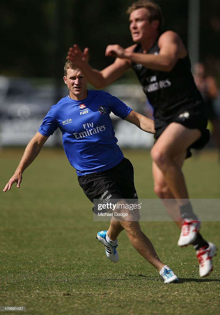 Coach <a gi-track='captionPersonalityLinkClicked' href=/galleries/search?phrase=Nathan+Buckley&family=editorial&specificpeople=176545 ng-click='$event.stopPropagation()'>Nathan Buckley</a> puts pressure on his players during a Collingwood Magpies AFL training session at Olympic Park on February 20, 2014 in Melbourne, Australia.