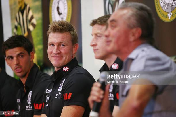 Coach Nathan Buckley reacts as former captain Tony Shaw speaks during the Collingwood Magpies AFL season launch at the Westpac Centre on March 11...