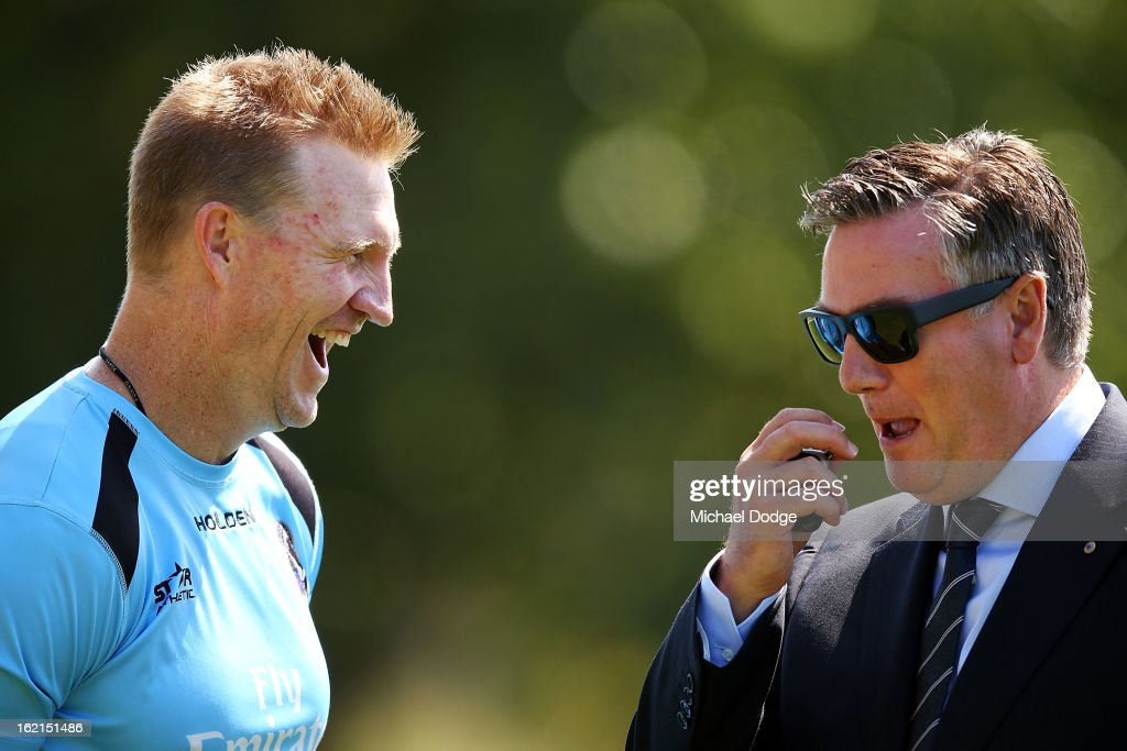 Coach Nathan Buckley reacts when talking with President Eddie McGuire during a Collingwood Magpies AFL training session at Gosch's Paddock on...