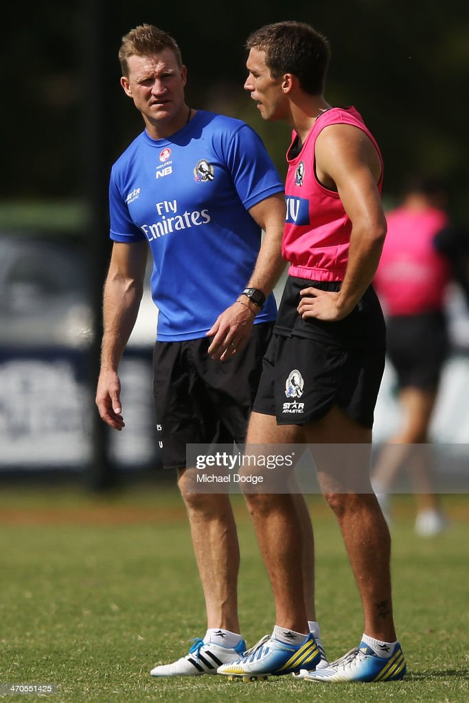 Coach <a gi-track='captionPersonalityLinkClicked' href=/galleries/search?phrase=Nathan+Buckley&family=editorial&specificpeople=176545 ng-click='$event.stopPropagation()'>Nathan Buckley</a> speaks to Clinton Young during a Collingwood Magpies AFL training session at Olympic Park on February 20, 2014 in Melbourne, Australia.