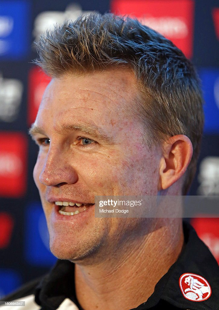 Coach <a gi-track='captionPersonalityLinkClicked' href=/galleries/search?phrase=Nathan+Buckley&family=editorial&specificpeople=176545 ng-click='$event.stopPropagation()'>Nathan Buckley</a> talks during the Collingwood Magpies 2013 Captaincy And Leadership Group Announcement at Melbourne Airport on February 5, 2013 in Melbourne, Australia.
