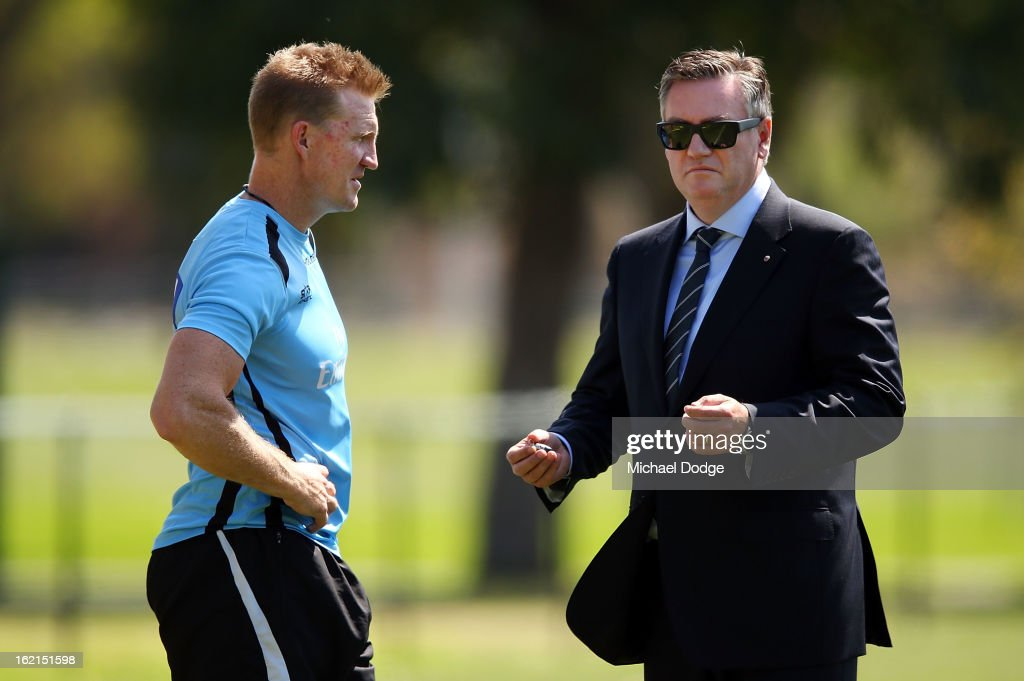 Coach Nathan Buckley talks with President Eddie McGuire during a Collingwood Magpies AFL training session at Gosch's Paddock on February 20 2013 in...