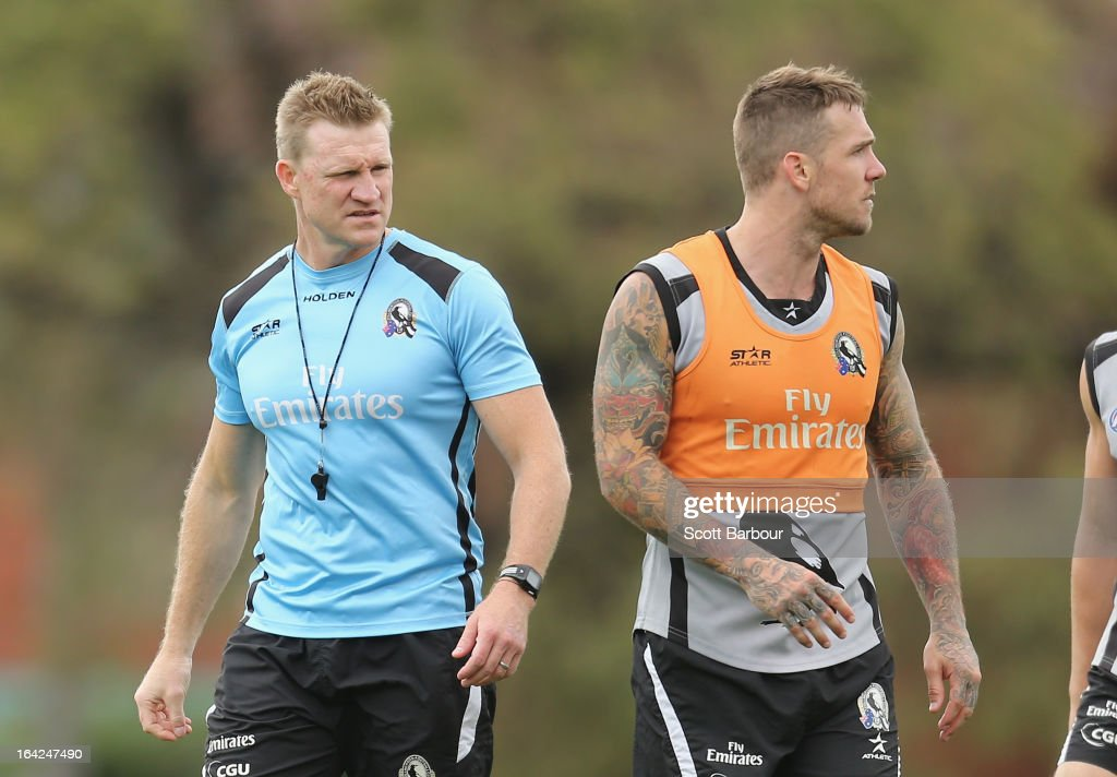 Coach <a gi-track='captionPersonalityLinkClicked' href=/galleries/search?phrase=Nathan+Buckley&family=editorial&specificpeople=176545 ng-click='$event.stopPropagation()'>Nathan Buckley</a> watches <a gi-track='captionPersonalityLinkClicked' href=/galleries/search?phrase=Dane+Swan&family=editorial&specificpeople=596987 ng-click='$event.stopPropagation()'>Dane Swan</a> of the Magpies during a Collingwood Magpies AFL training session at Gosch's Paddock on March 22, 2013 in Melbourne, Australia.