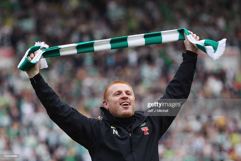Coach <a gi-track='captionPersonalityLinkClicked' href=/galleries/search?phrase=Neil+Lennon&family=editorial&specificpeople=642944 ng-click='$event.stopPropagation()'>Neil Lennon</a> of Celtic celebrates following his team clinching the Scottish Clydesdale Bank Scottish Premier League title after the match between Kilmarnock and Celtic at Rugby Park on April 7, 2012 in Kilmarnock, Scotland.