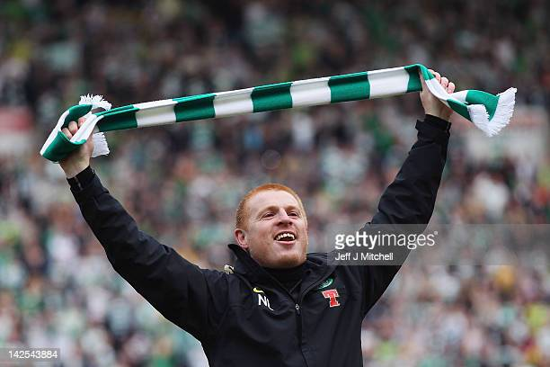 Coach Neil Lennon of Celtic celebrates following his team clinching the Scottish Clydesdale Bank Scottish Premier League title after the match...
