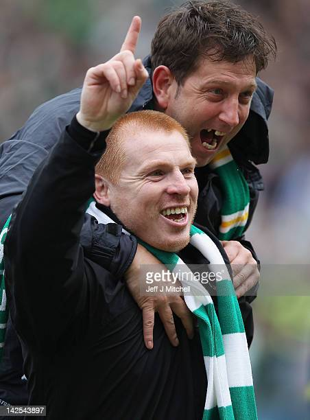 Coach Neil Lennon of Celtic celebrates with Garry Parker following his team clinching the Scottish Clydesdale Bank Scottish Premier League title...