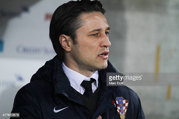 Coach Niko Kovac of Croatia stands for the national anthem prior the international friendly match between Switzerland and Croatia at the AFG Arena on...