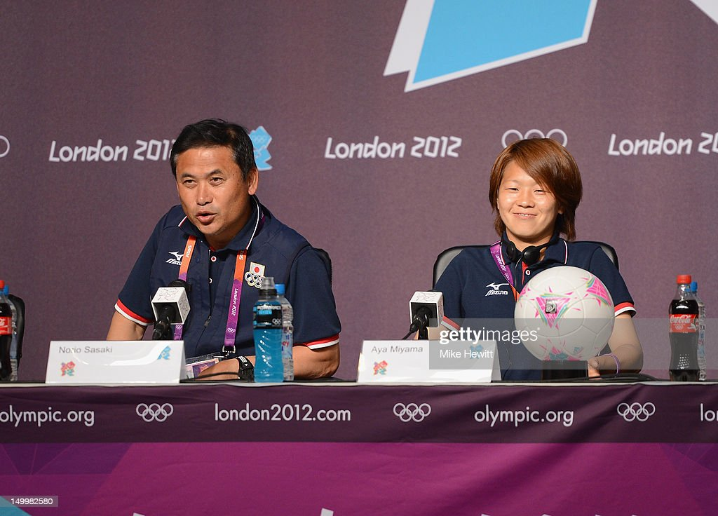 Coach Norio Sasaki and captain Aya Miyama of the Japan Women's football team face the media during a press conference ahead of the Women's Football Final between Japan and United States at Olympic Park on August 8, 2012 in London, England.