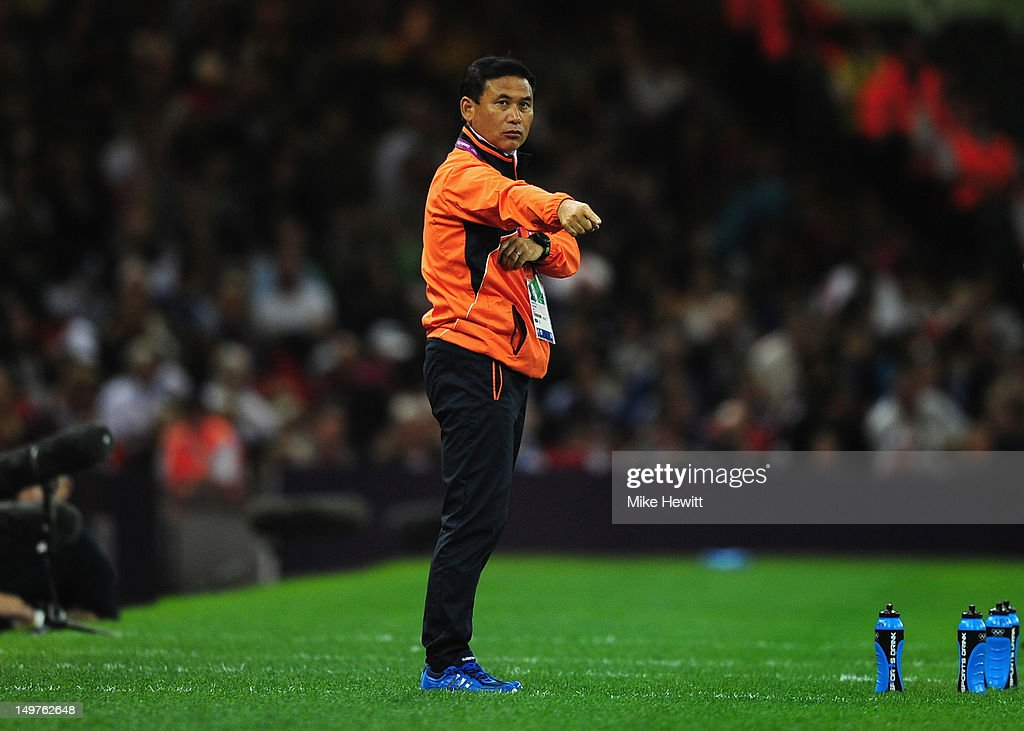 Coach Norio Sasaki of Japan looks on during the Women's Football Quarter Final match between Brazil and Japan, on Day 7 of the London 2012 Olympic Games at Millennium Stadium on August 3, 2012 in Cardiff, Wales.