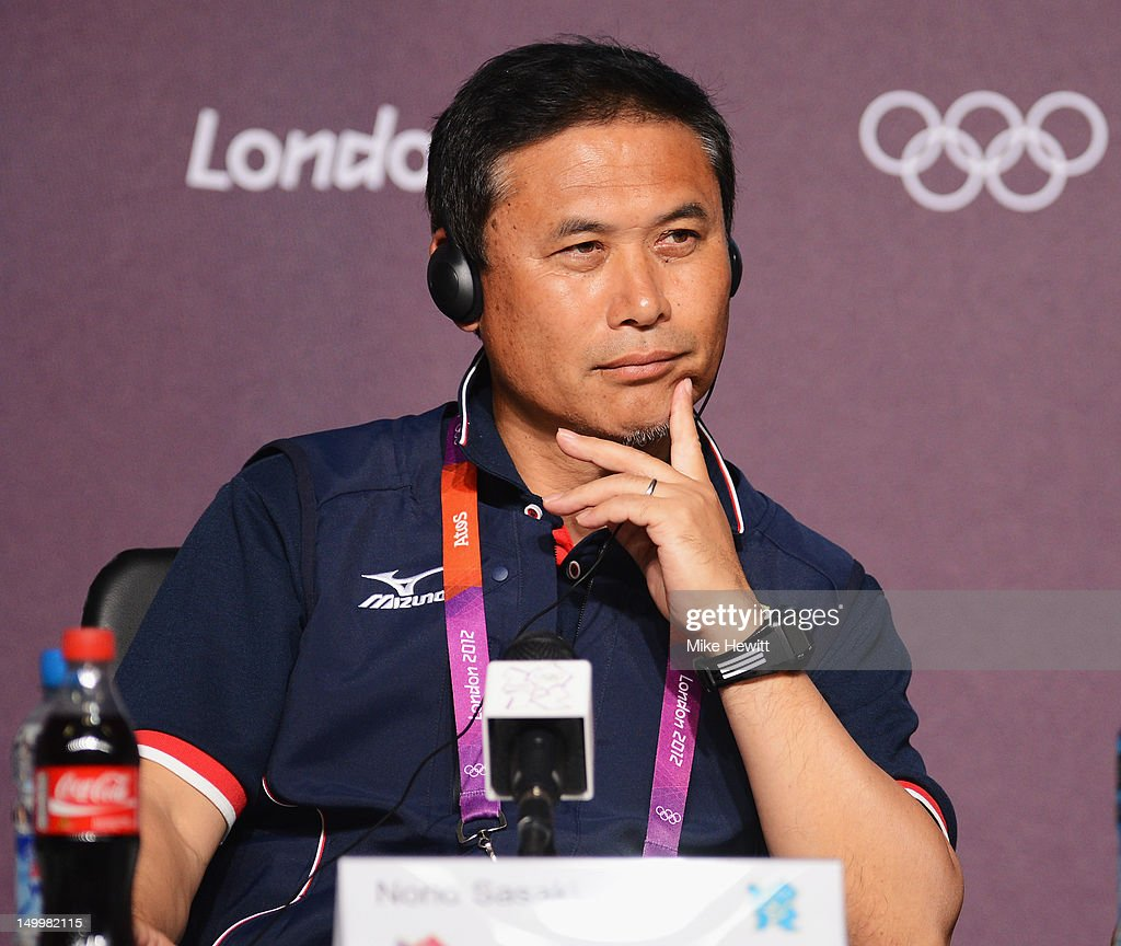 Coach Norio Sasaki of the Japan Women's football team faces the media during a press conference ahead of the Women's Football Final between Japan and United States at Olympic Park on August 8, 2012 in London, England.