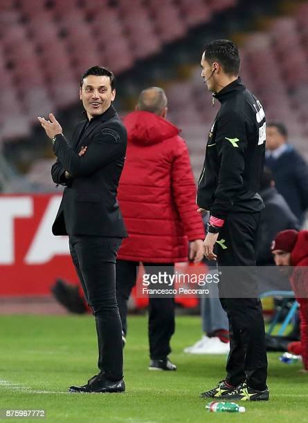 Coach of AC Milan Vincenzo Montella talks to the fourth man Marco Di Bello during the Serie A match between SSC Napoli and AC Milan at Stadio San...