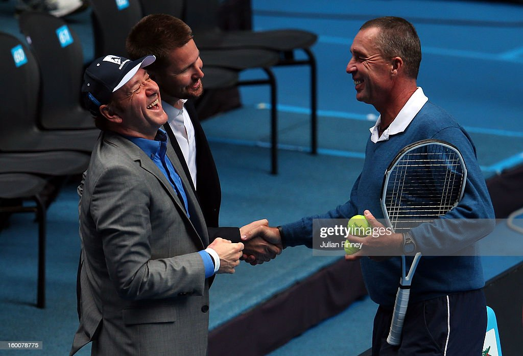 Coach of Andy Murray of Great Britain, Ivan Lendl, shakes hands with actor Kevin Spacey while Murray takes part in a practice session during day thirteen of the 2013 Australian Open at Melbourne Park on January 26, 2013 in Melbourne, Australia.