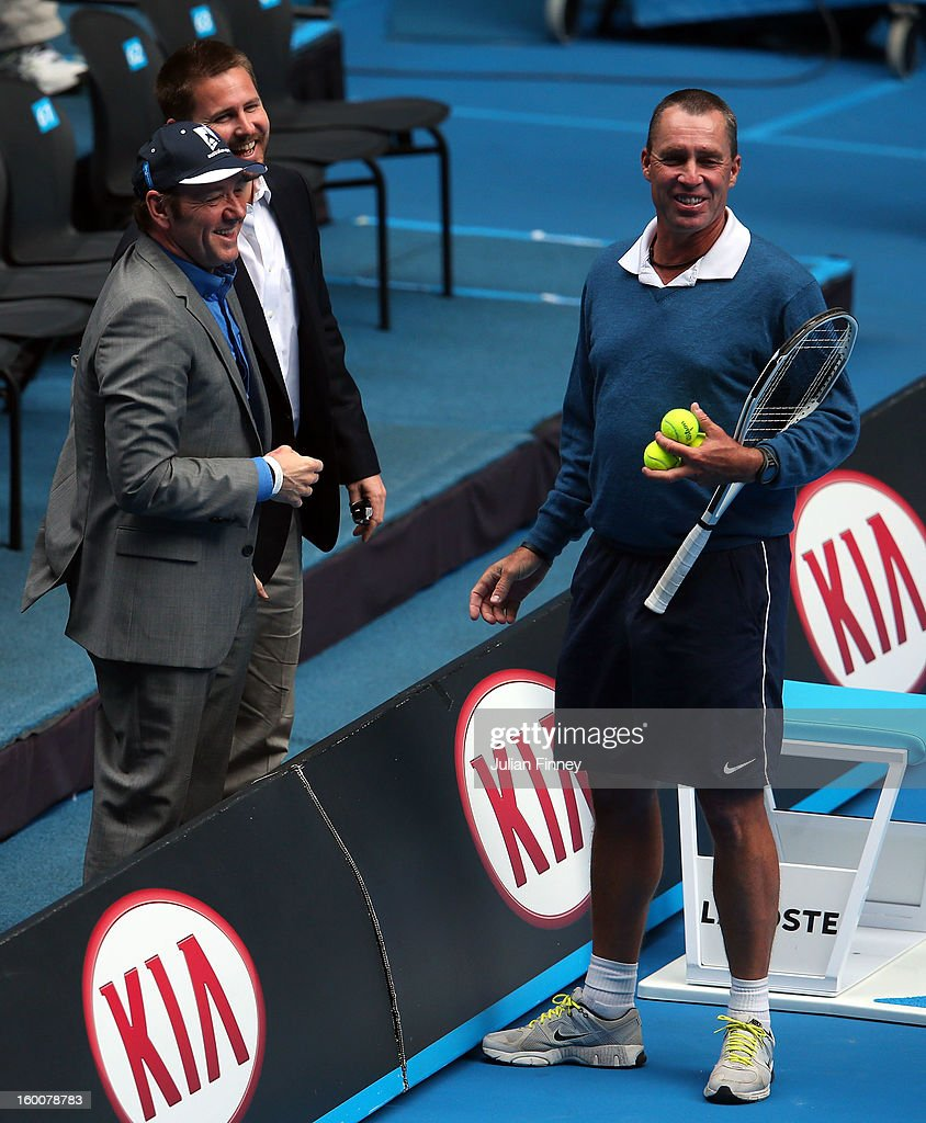 Coach of Andy Murray of Great Britain, Ivan Lendl, talks with actor Kevin Spacey while Murray takes part in a practice session during day thirteen of the 2013 Australian Open at Melbourne Park on January 26, 2013 in Melbourne, Australia.
