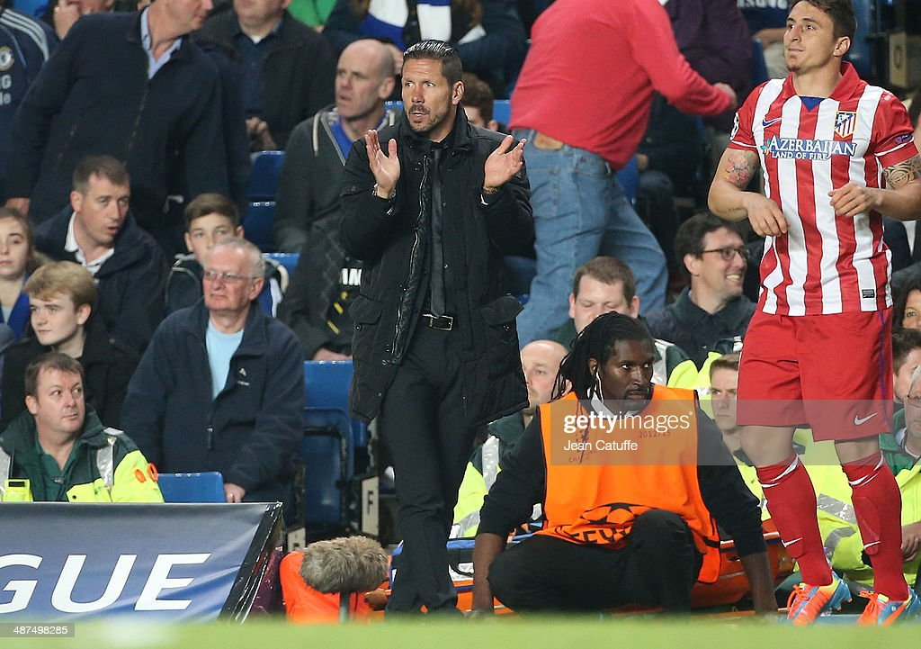 Coach of Atletico Madrid Diego Simeone cheers for his players during the UEFA Champions League semi final second leg match between Chelsea FC and Club Atletico de Madrid at Stamford Bridge stadium on April 30, 2014 in London, England, United Kingdom.