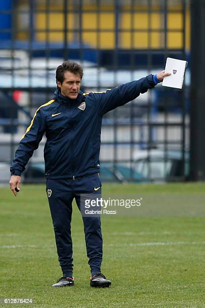 Coach of Boca Juniors Guillermo Barros Schelotto gives instructions during a Boca Juniors training session at Complejo Pedro Pompilio on October 05...