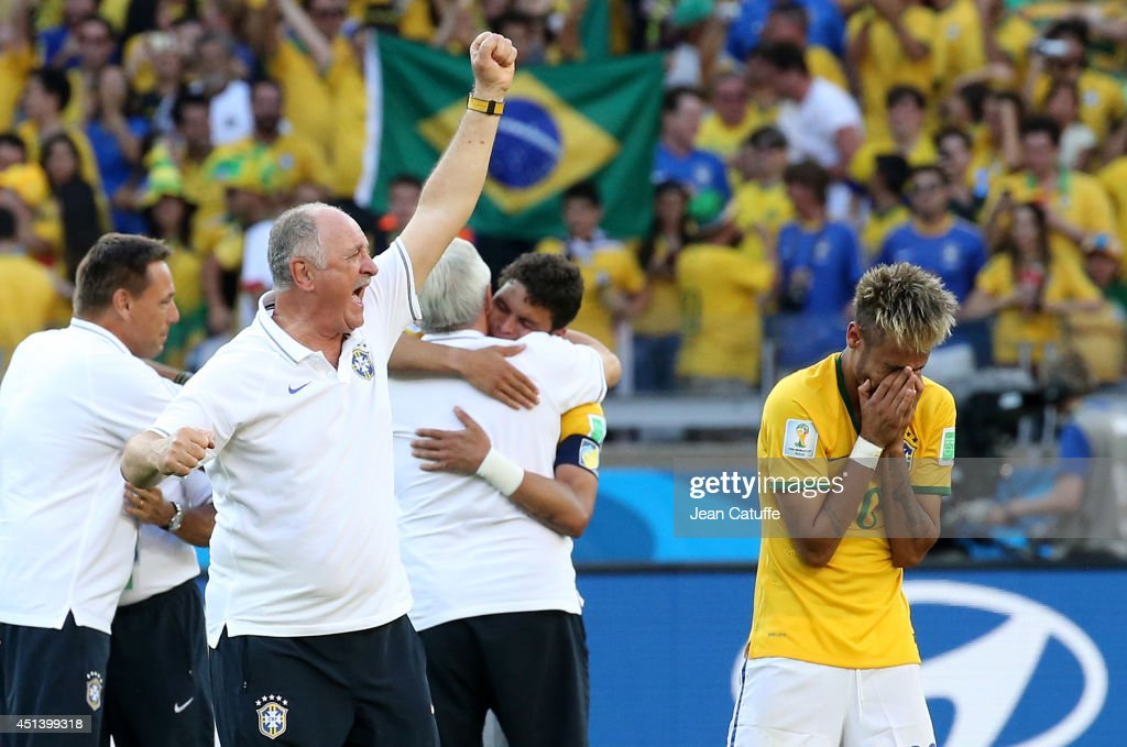 Coach of Brazil Luiz Felipe Scolari and Neymar celebrate the win through a penalty shootout after the 2014 FIFA World Cup Brazil round of 16 match between Brazil and Chile at Estadio Mineirao on June 28, 2014 in Belo Horizonte, Brazil.