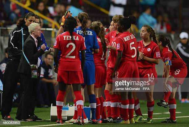 Coach of Canada Beverly Priestman talks to her players during the FIFA U17 Women's World Cup Group B match between Canada and Ghana at Ricardo...
