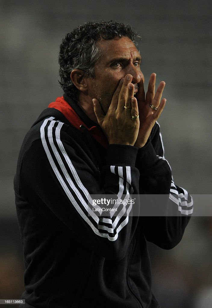 Coach of Estudiantes de La Plata Diego Cagna during a match between Estudiantes and Racing as part of the 7th round of the Torneo Final 2013 at...