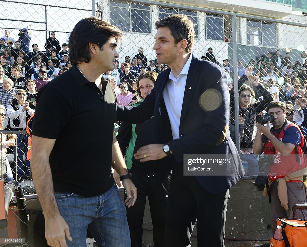 Coach of Estudiantes, <a gi-track='captionPersonalityLinkClicked' href=/galleries/search?phrase=Mauricio+Pellegrino&family=editorial&specificpeople=2236854 ng-click='$event.stopPropagation()'>Mauricio Pellegrino</a> greets Rubén Forestello, coach of San Martín de San Juan on during a match between San Martin de San Juan and Estudiantes de La Plata as part of the Torneo Final 2013 at the Ingeniero Hilario Sanchez stadium on June 15, 2013 in San Juan, Argentina.