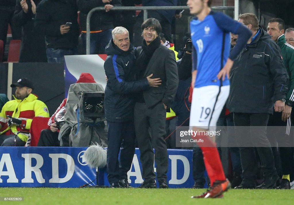 Coach of France Didier Deschamps greets coach of Germany Joachim Low following the international friendly match between Germany and France at RheinEnergieStadion on November 14, 2017 in Cologne, Germany.