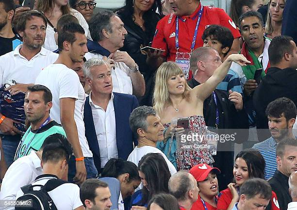 Coach of France Didier Deschamps meets Nagui and his wife Melanie Page above him JeanPierre Bernes following the UEFA Euro 2016 semifinal match...