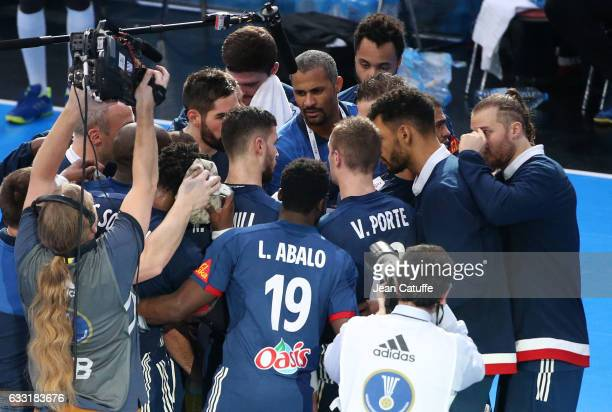 Coach of France Didier Dinart talks to his players during a time out during the 25th IHF Men's World Championship 2017 Final between France and...