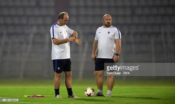 Coach of France Lionel Rouxel checks the time during a training session ahead of the FIFA U17 World Cup India 2017 tournament on October 16 2017 in...