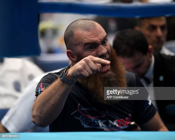Coach of France's Zakaria Laaouatni reacts during the fight with Belarus' Kiryl Marchanka in the K1 75kg category in the ring of the 'BOK' sports...