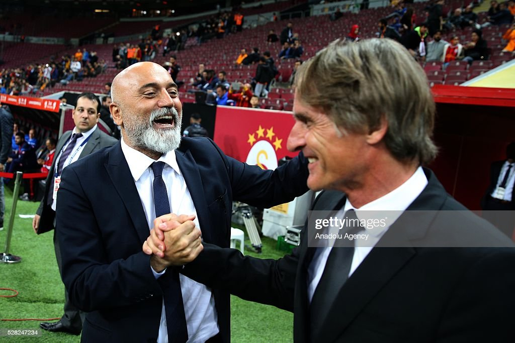 Coach of Galatasaray Jan Olde Riekerink (R) and Coach of Caykur Rizespor Hikmet Karaman shake hands during the Ziraat Turkish Cup Semi Final second leg football match between Galatasaray and Caykur Rize Spor at Turk Telekom Arena in Istanbul, Turkey on May 4, 2016.