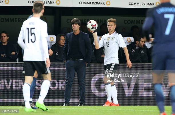 Coach of Germany Joachim Loew looks on while Joshua Kimmich of Germany holds the ball during the international friendly match between Germany and...