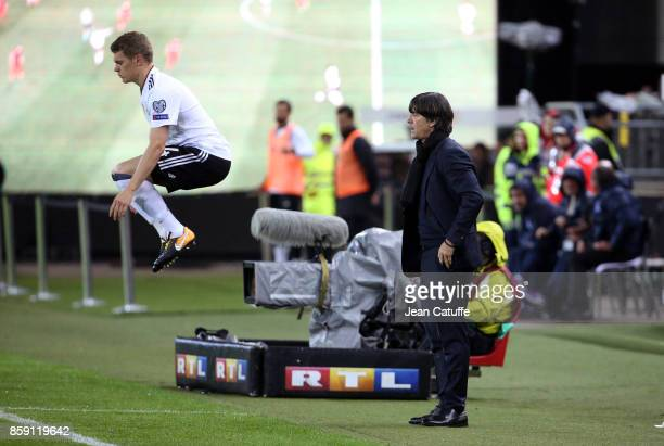 Coach of Germany Joachim Low looks on while Matthias Ginter of Germany gets ready to enter the pitch during the FIFA 2018 World Cup Qualifier between...