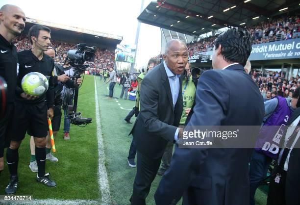 Coach of Guingamp Antoine Kombouare greets coach of PSG Unai Emery before the French Ligue 1 match between En Avant Guingamp and Paris Saint Germain...
