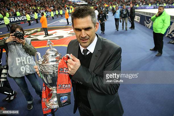Coach of Guingamp Jocelyn Gourvennec holds the trophy after the French Cup Final between Stade Rennais FC and EA Guingamp at Stade de France on May 3...
