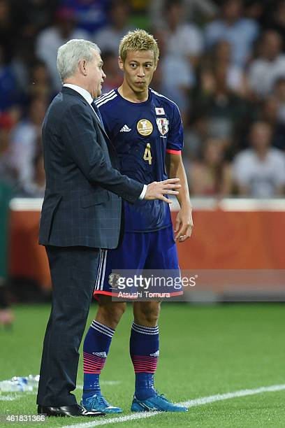 Coach of Japan Javier Aguirre speaks to his player Keisuke Honda of Japan during the 2015 Asian Cup match between Japan and Jordan at AAMI Park on...